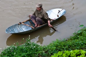 Man in small fishing boat in North Vietnam